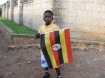 PROUD UGANDAN: A Ugandan boy carries a flag. Uganda celebrates its 50th Independence anniversary on October, 9, 2012. Uganda achieved independence from the British on October, 9, 1962. PHOTO CREDIT: billstravelblogugandakenya.blogspot.com